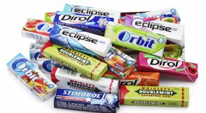 TULA, RUSSIA - APRIL 28, 2014: Heap of various brand chewing or bubble gum including Orbit, Dirol, Eclipse, Stimorol, Wrigley Spearmint and Doublemint isolated on white with clipping path